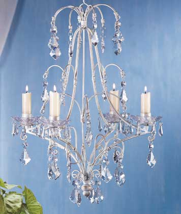bring a touch of elegance into your home with this elegant candle chandelier this chandelier holds four tapers and has acrylic drop decorations